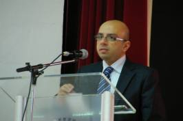 Delivering a presentation during the conference on Ethics.